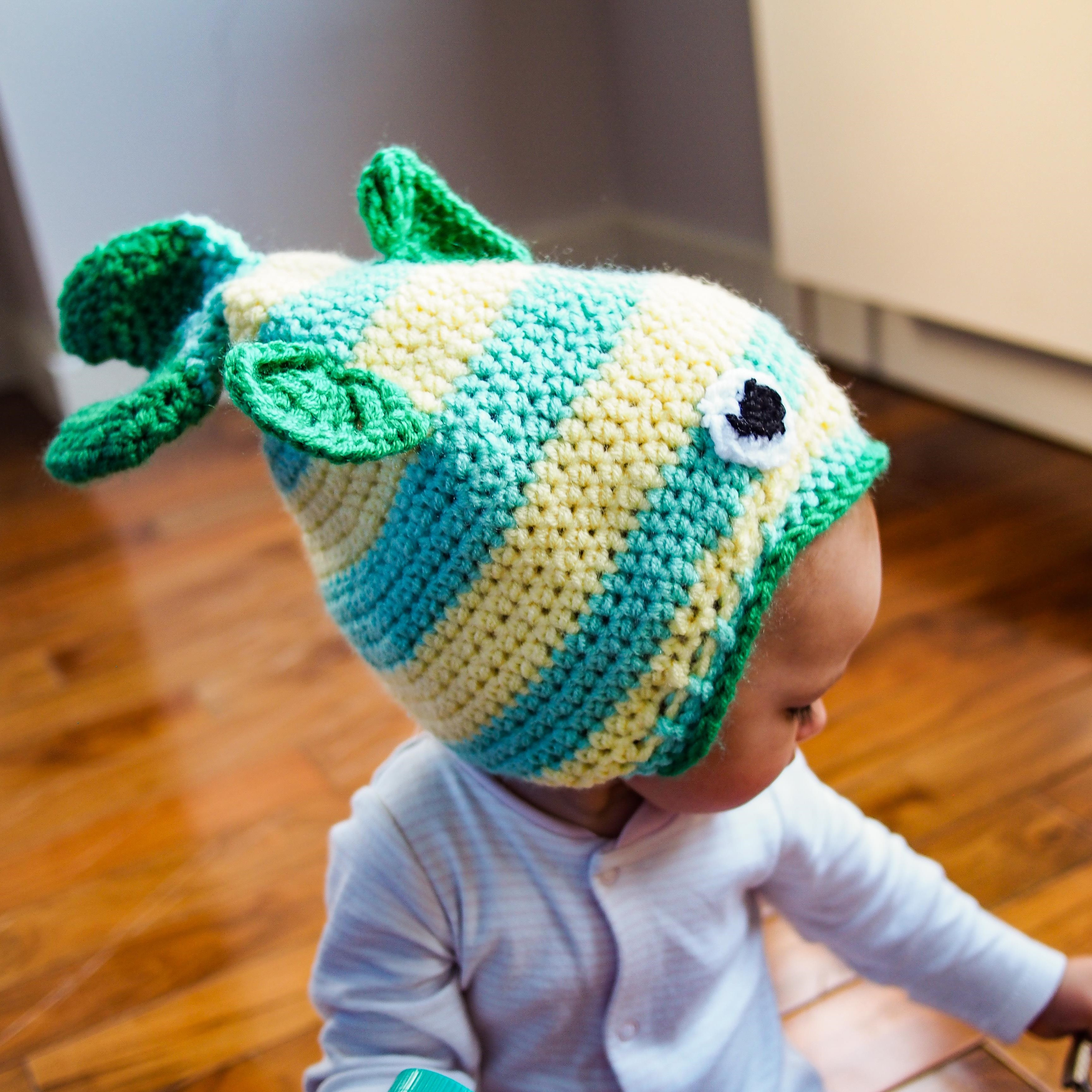 green and yellow fish hat