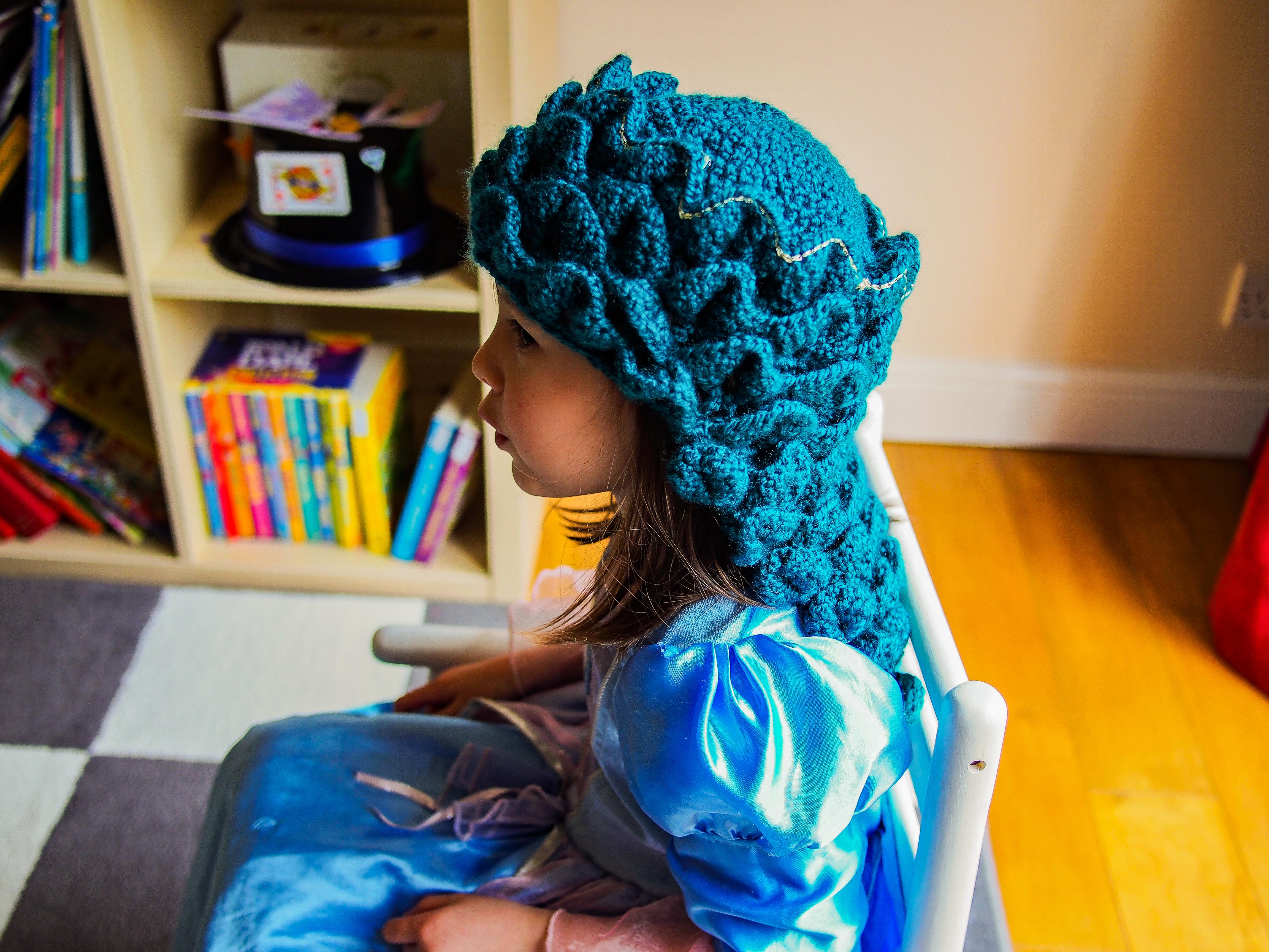 side view of mother dragon hat
